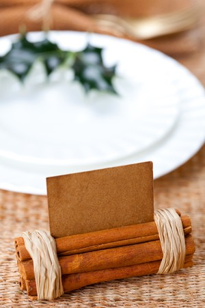 aromatic christmas place setting place  with card, holly twig in white plate, shallow dof Stock Photo - 8139667
