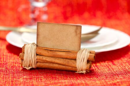 aromatic christmas place setting place  with card, white plate, shallow dof Stock Photo - 8139699