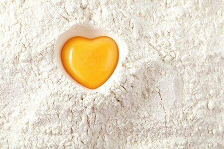 love to bake it!  egg  yolk on flour, full frame Stock Photo - 8139694