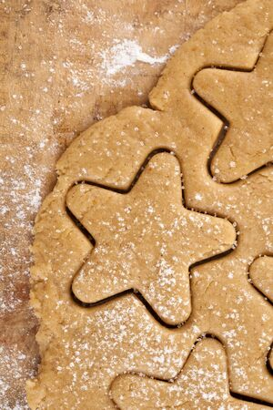 gingerbread  star cookie cuts dough, background photo