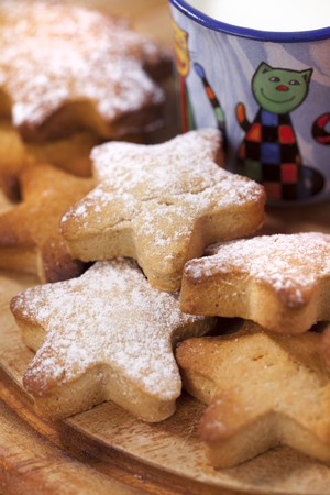 homemade gingerbread  star cookies with  kids milk on wooden table photo