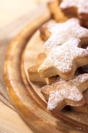 homemade gingerbread  star cookies on wood photo