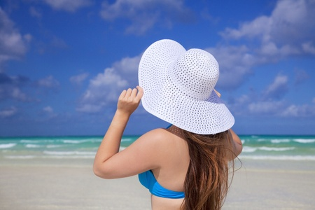 sun hat: girl with white sun hat and  carribean sea