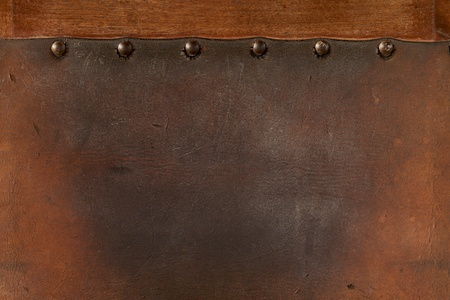 old  weathered leather tacked  photo