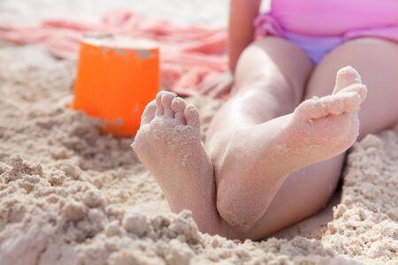 kid on golden beach sand, shallow dof photo