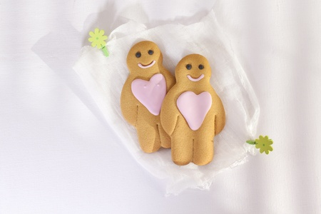 gingerbread boy and girl under morning sun,white linen  backdrop photo
