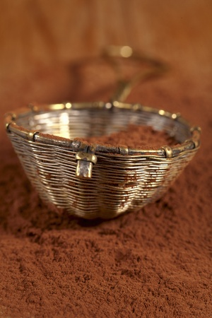 sieve: old rustic style silver sieve with cocoa powder in , shallow dof