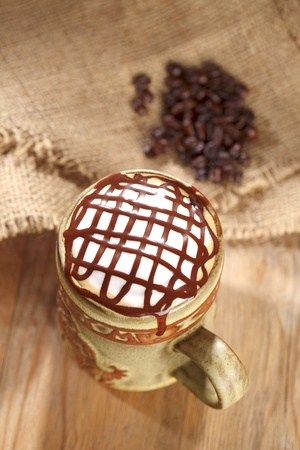 hot frothy  coffee cappuccino chocolate topping, in rustic style, shallow dof Stock Photo - 9047372