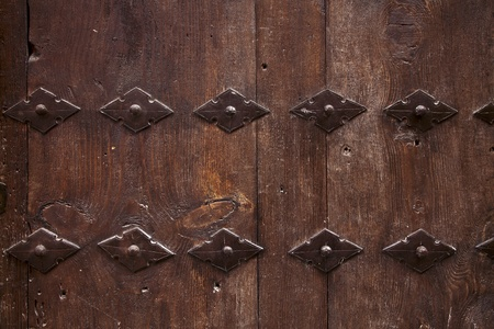 old wooden door with metal ornate background photo