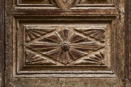 old ornamental design in wood, wooden carved door detail photo