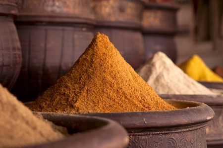Spices pile (Curry Powder) in the  Marrakesh street shop, shallow dof photo