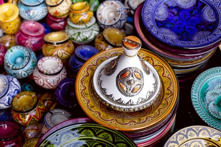 decorated tagine and traditional morocco souvenirs in medina souk photo