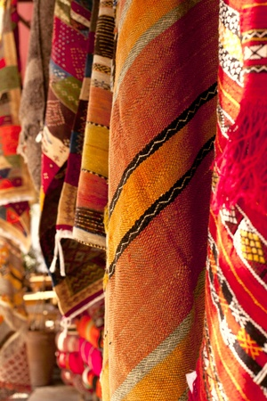 Moroccan Carpets in a street shop souk photo