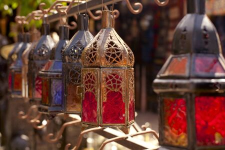 Moroccan glass and metal lanterns lamps in Marrakesh souq Stock Photo