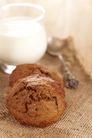 soft ginger cookie with glass of milk, shallow dof Stock Photo