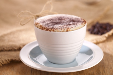 hot frothy drink cappuccino coffee, rustic style, shallow dof photo