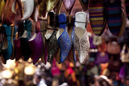souk: Ornamented traditional moroccan shoes in medina street souk Stock Photo