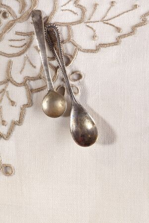 chabby: two retro coffee spoons tied on embroidered serviette
