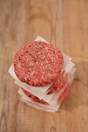 beefburger: Raw burgers for hamburgers, in a pile