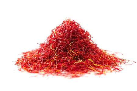 moroccan saffron treads in pile, isolated on white, shallow dof