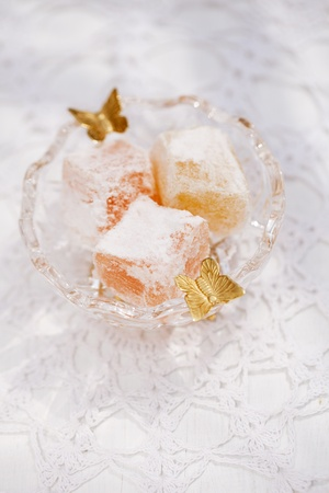turkish sweet delight, rose and yellow, in small glass bowl butterfly decorated photo