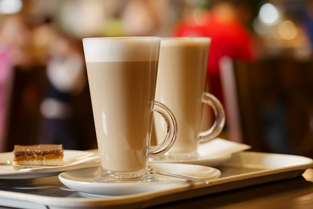 sweet shop: coffee latte in two tall glasses, shallow dof