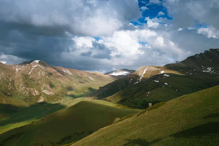 kyrgyz republic: Spring mountains with snow and cloudy sky.Taken in the Kyrgyz Highlands.