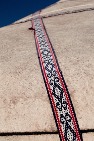nomad yurt detail - thick felt background and rope photo
