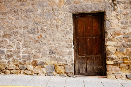 very old wooden door and stone wall
