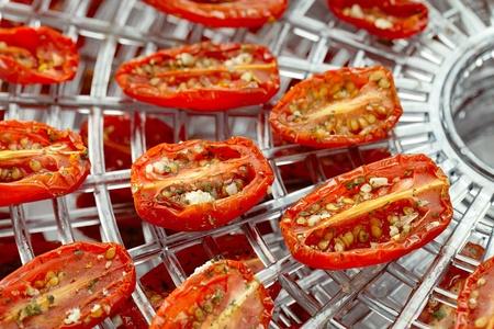 sun-dried tomatoes on dehydrator tray