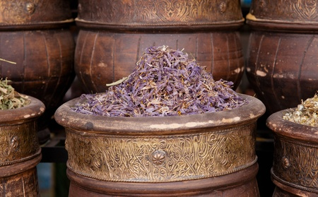 dried herbs flowers  in the  Marrakesh street shop, shallow dof photo