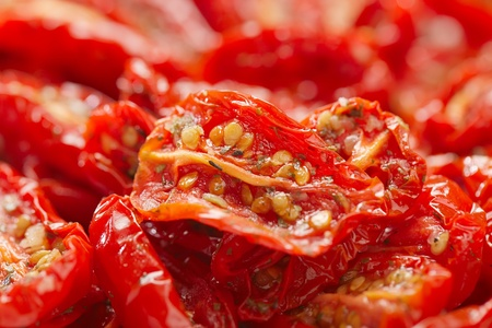 slice tomato: sun-dried tomatoes with olive oil, background, shallow dof Stock Photo