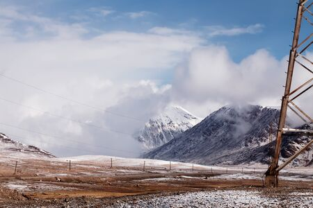 kirgizia: Power line in Barskoon valley in Kyrgyzstan, high Tyan Shan mountains
