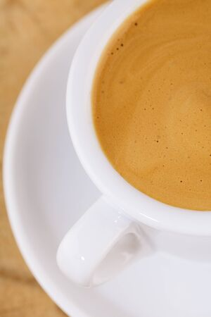 expresso: espresso coffee in thick white cup, on wood, closeup, shallow dof Stock Photo