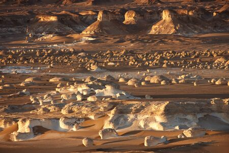 The sunset view on limestone formation rocks in the White Desert, Egypt photo
