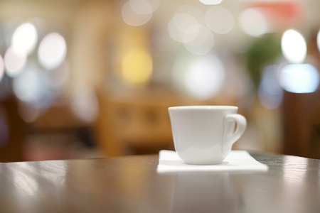 expresso: espresso coffee in thick white cup in a cafe, super shallow dof