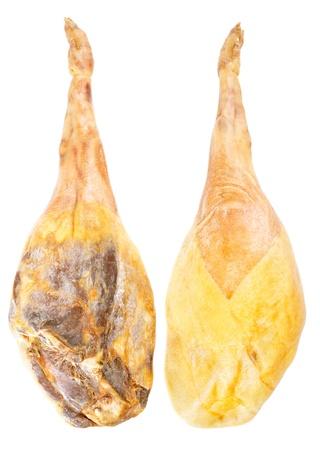 Jamon serrano, toute la jambe deux côtés, un jambon espagnol isolé sur blanc