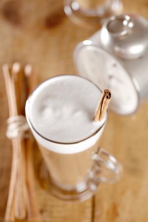 coffee latte with cinnamon sticks, focus on stiks end, , shallow dof Stock Photo - 13108367