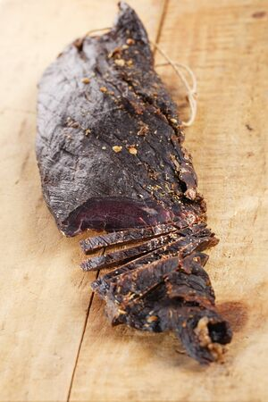 Biltong - dry cured beef meat,cutted Stock Photo