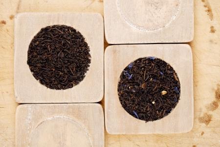 Earl Grey and Lady Grey black loose tea leaves on wood Stock Photo - 13743410