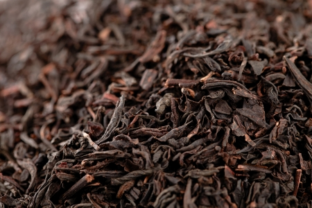 Earl Grey  black loose tea leaves background, shallow dof photo