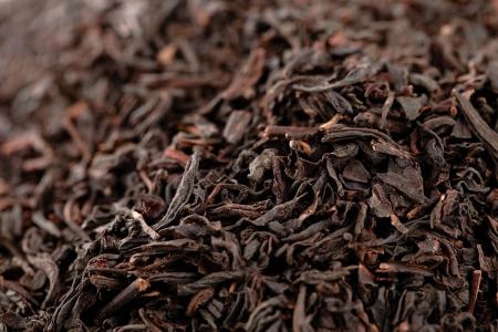 Earl Grey  black loose tea leaves background, shallow dof photo