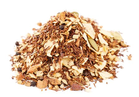 red rooibos with ginger, toasted coconut, black pepper, cinnamon, apple and almond, pile over white photo