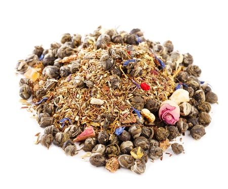 caffeinated: jasmine pearls green tea with red and green rooibos blend, over white Stock Photo