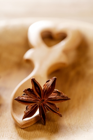 anis star in heart shape wooden spoon, shallow dof photo
