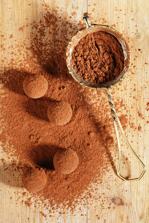 sieve: chocolate truffles cocoa powder dusted and sieve, shallow dof