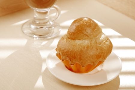french Brioche and white cup of Coffee   photo
