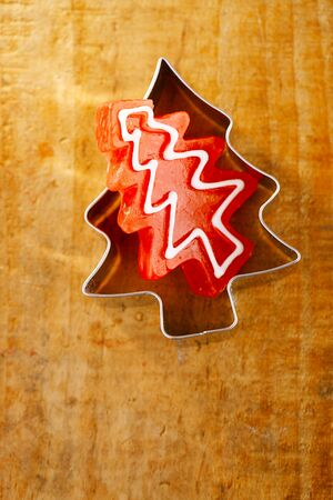 cookie cutter: christmas tree red candy in cookie cutter, wooden background