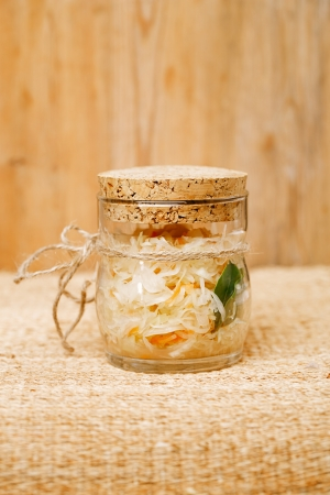 Sour cabbage - sauerkraut - in glass jar photo