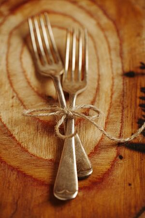two fork tied by string on old wood, selective focus, shallow dof Stock Photo - 16810295